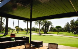 closed lourvers giving shade for golfers