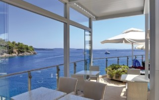 reson lourvered canopy for restaurant overlooking the sea